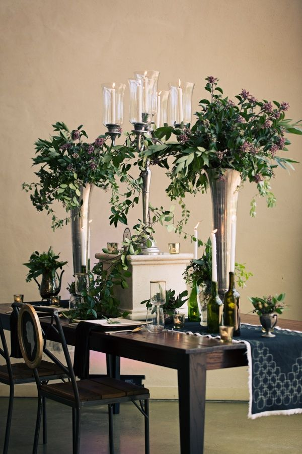 The tall centerpieces wil be silver vases filled with a