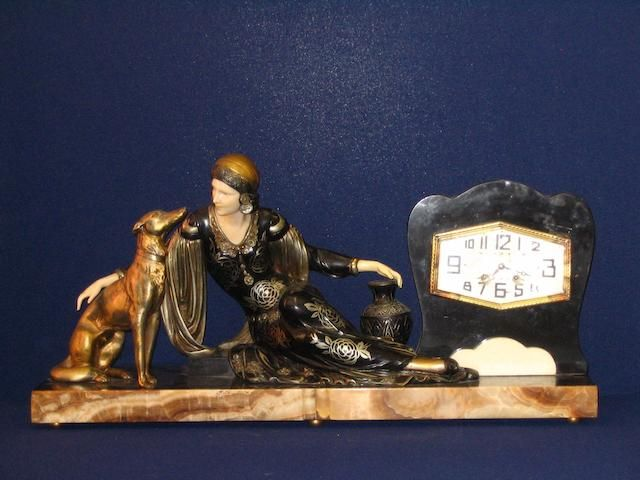 An Art Deco period cold painted and ivorine clock garniture
