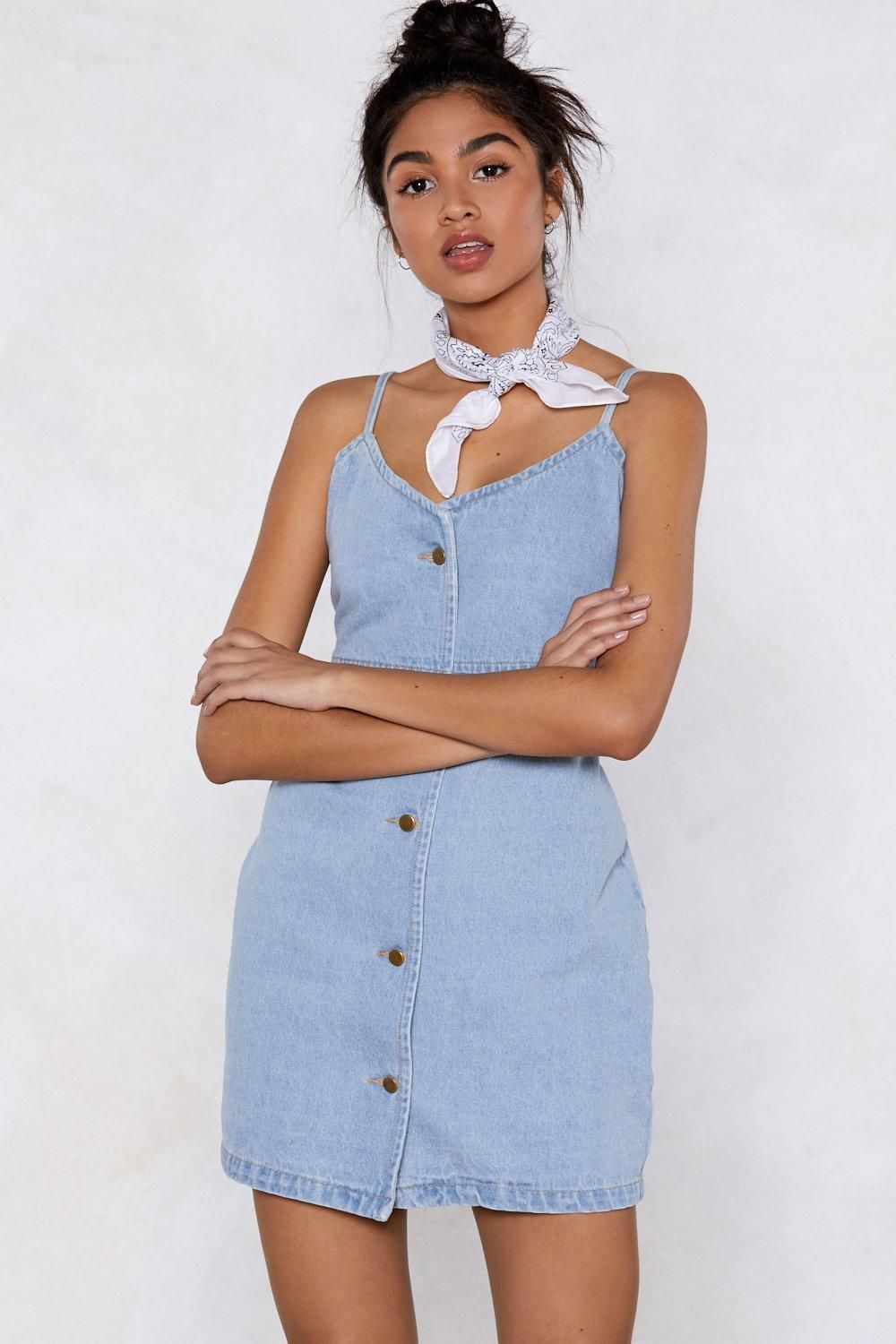 7314eae6f42 The Come Together Dress comes in light wash denim and features a mini
