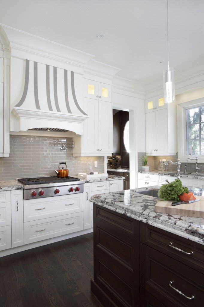 A raised dark wood kitchen island nearly