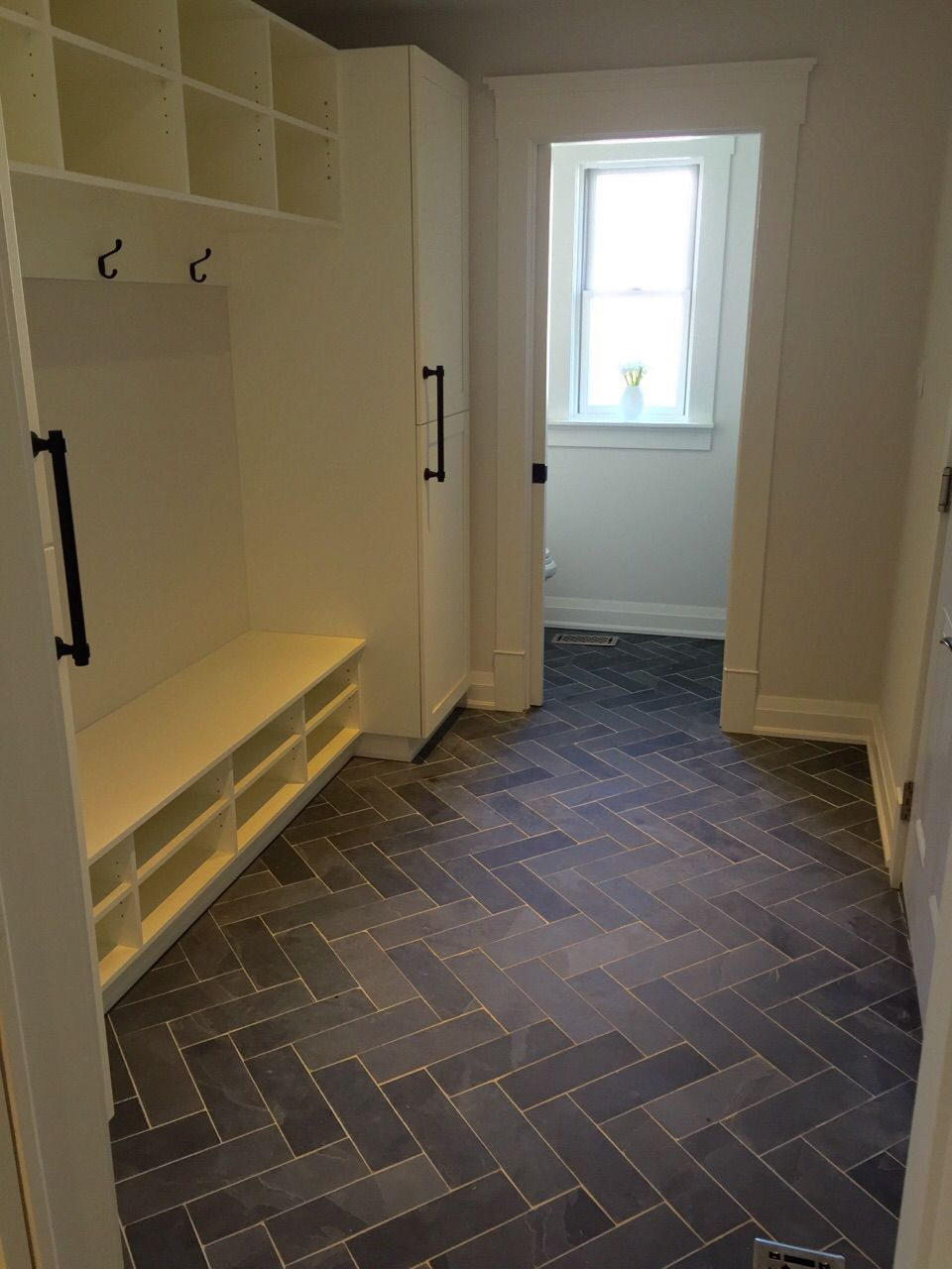 Mudroom powder room flooring slate tile done in the for Mudroom floor
