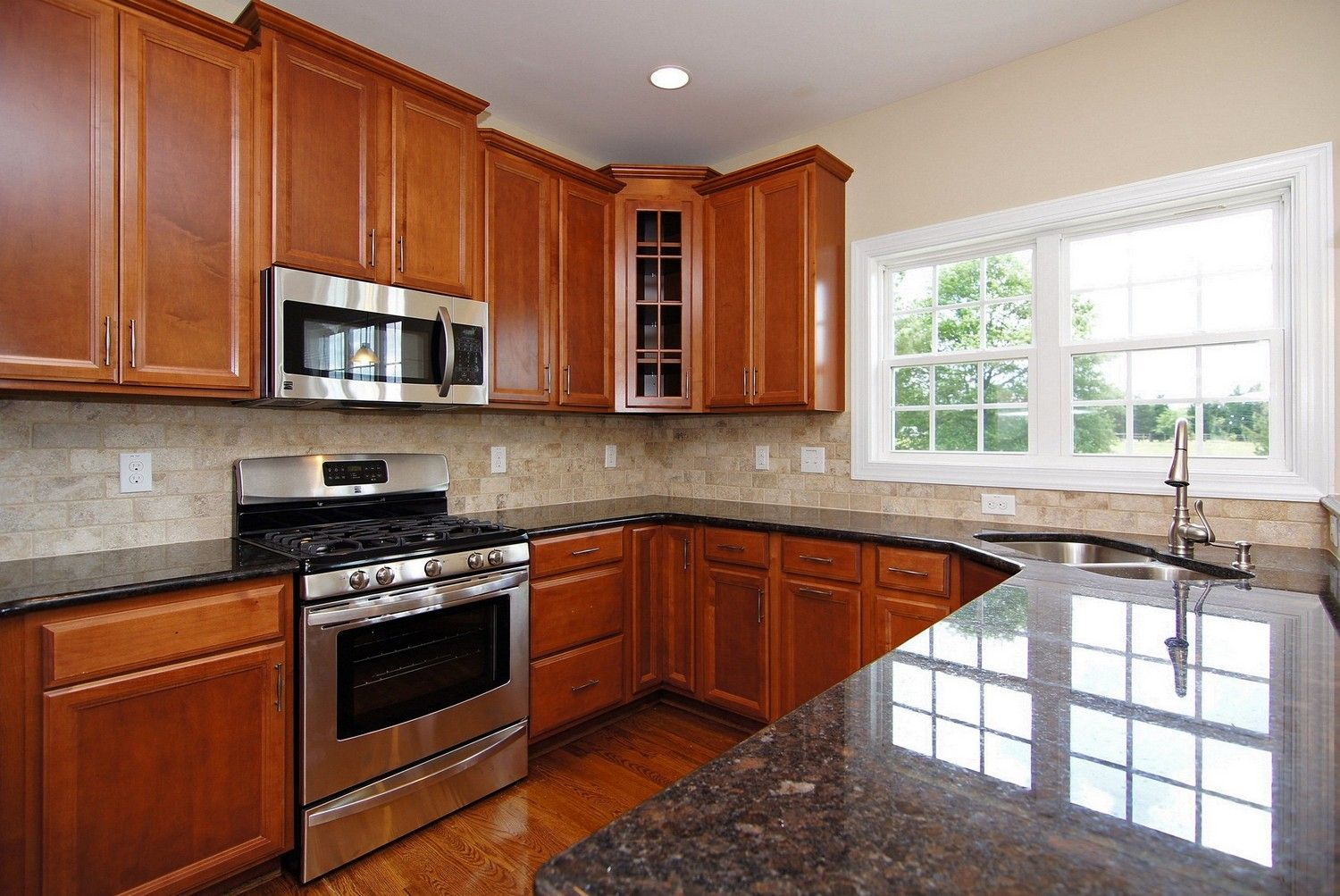 Peninsula Kitchen Ideas With Black Granite Counter Tops Stainless