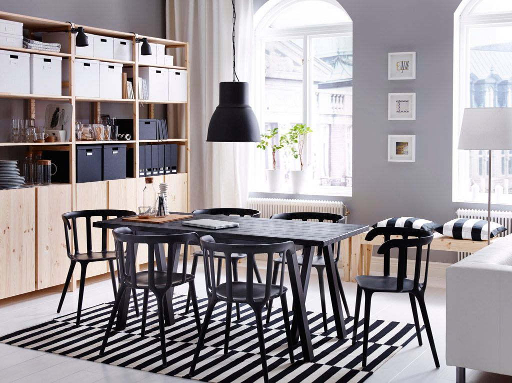 A Large Dining Room With Black Table And Six Chairs Combined Storage In Solid Pine