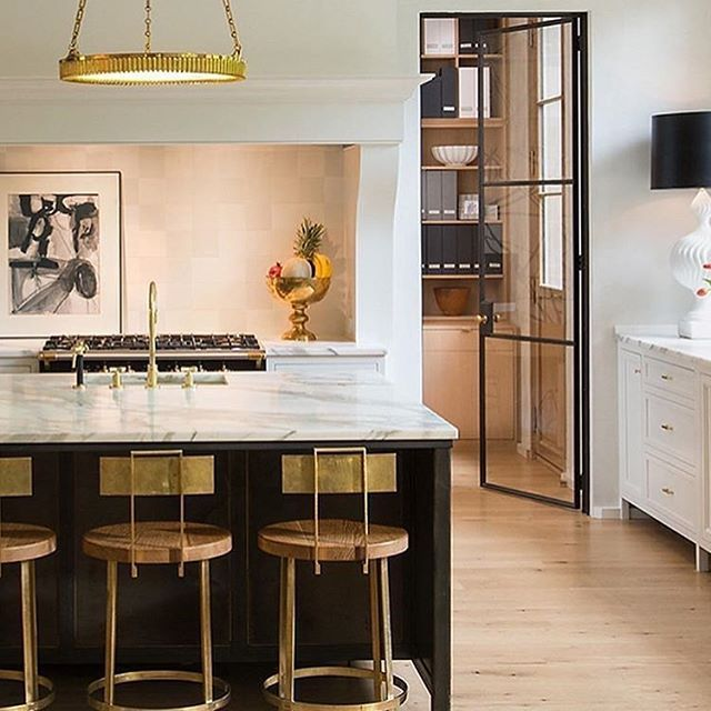 Found this gorgeous kitchen by @banksdevelopment via @kateabtdesign we certainly share the same taste in design - What more could you ask for with a steel door, stunning marble and a touch of brass.  Perfection! . . . . . . #kateabtdesign #interiordesign #design #interiors #whitekitchen #kitchen #brass #kitchenisland #marble #backsplash #lighting #chandelier #steeldoors #woodfloors #whiteoak #blackisland #backsplash #custom #bespoke #luxuryinteriors #luxdesign #instadesign #homedecor #lightin...