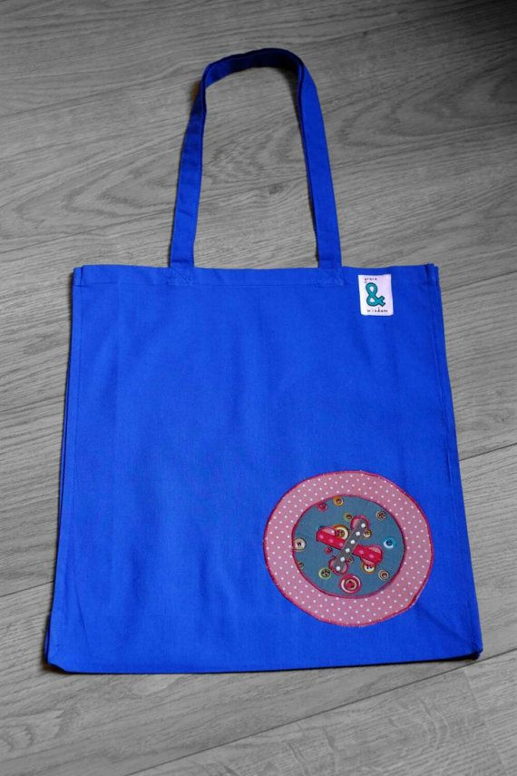 Check out this item in my Etsy shop https://www.etsy.com/listing/228955838/blue-cotton-bag-with-appliqued-button