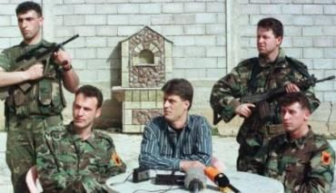 "Hashim Thaçi (center, in blue shirt) and his commanders of the ""Kosovo Liberation Army"" (KLA). Now, War Crime Charges. 06.20.2015 http://www.economist.com/news/europe/21654654-special-court-try-kosovars-war-crimes-moves-closer-where-past-isnt-even-past"