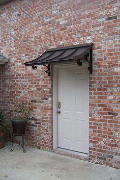 Short height metal awning over single doorway & CONCAVE METAL AWNING u2013 u2013 CUSTOM METAL AWNINGS u2013 Copper Awning ...