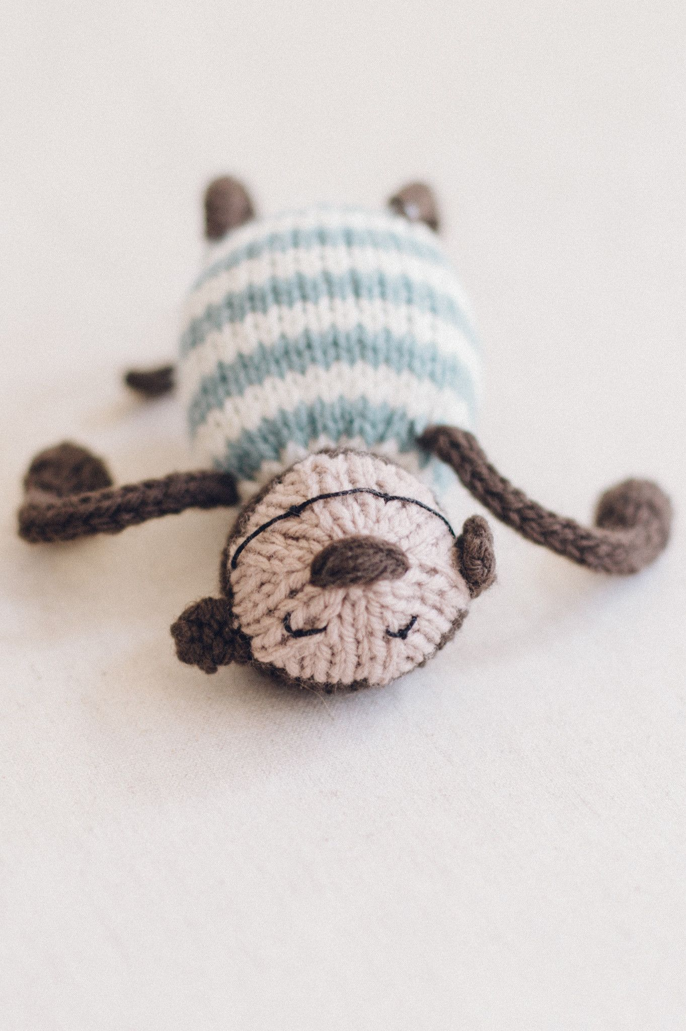 silly monkey, from the book string along toys by susan b. anderson / adorable knitted mice, frogs, and monkeys / in quince & co. lark, colors bark and chanterelle, with bird's egg and egret stripes