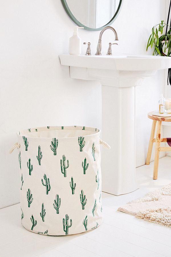 Cactus block print canvas laundry bag. collapsible cactus-patterned canvas laundry bag. with a collapsible construction and drawstring closure, featuring allover block print and dual rope carrying handles at sides. #bath #bathroom #laundry #organize #storage #bathroomlaundry