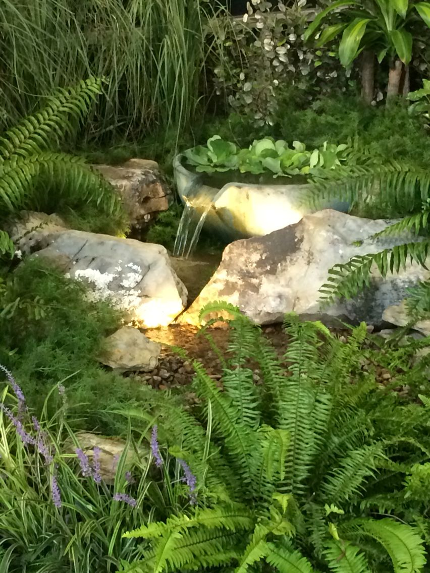 A cool spillway bowl feeds a small pondless waterfall