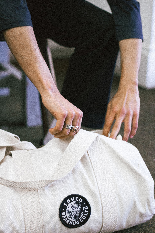 9660cec5422 The Bearhug Co - Black  Barrel Bag   thebearhug  barrelbag  blackbag   duffelbag  patch  streetwear