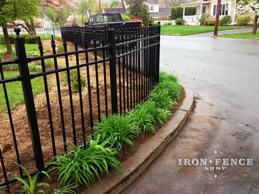 a closer view showing how aluminum fence can be made to follows curves with angle brackets