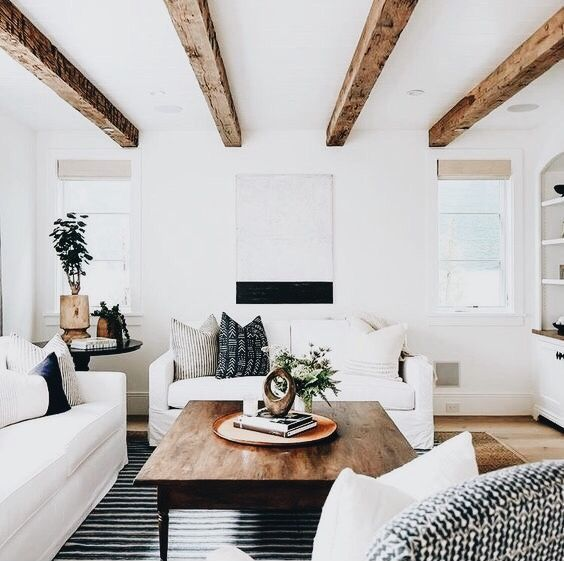 Bright White Living Room with Exposed Wood Ceiling Beams