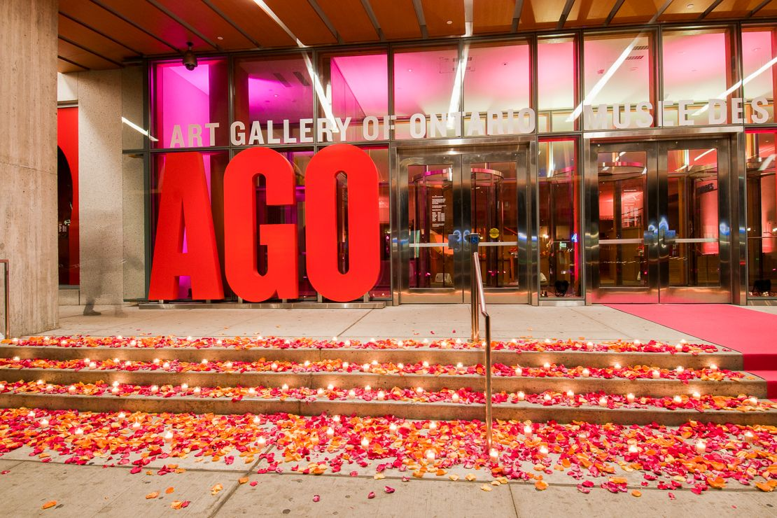 Bright pink carpet and scattered rose petals at the