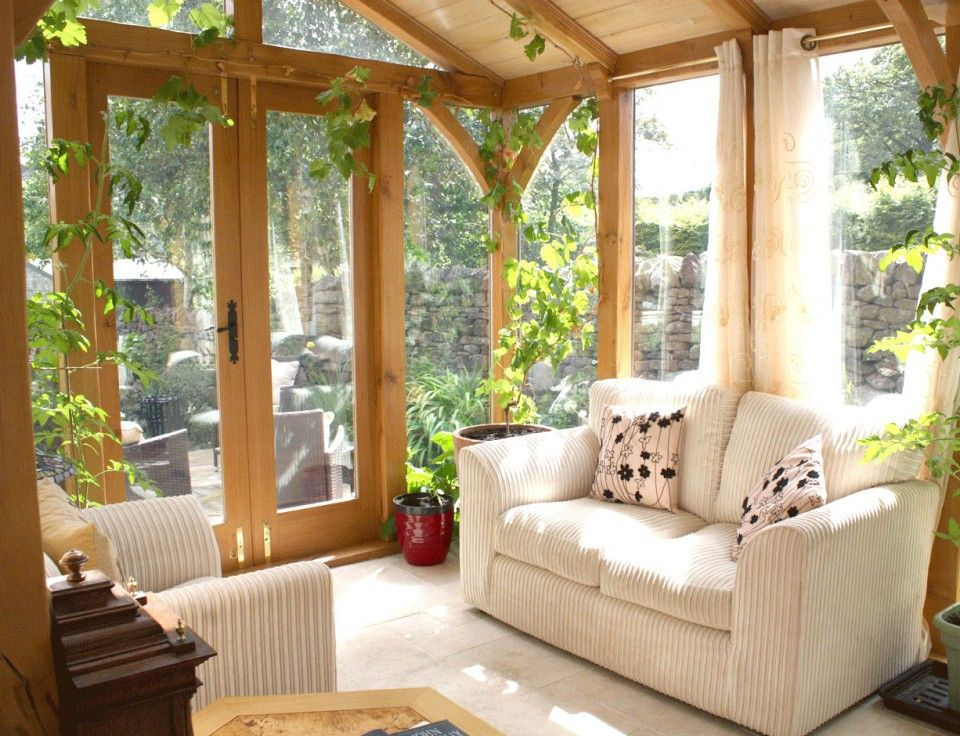 Pleasant Sunroom Interior Idea With White Corduroy Sofa And Arm Chair Also Glass Wall And Wood Pillars And Lovely Green Vines Adorable Sunroom Design Ideas: Adorable Sunroom Design Ideas That Will Dazzle You