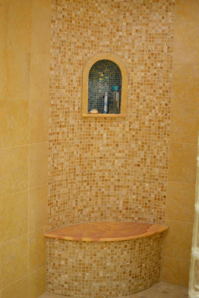Tile Projects-church window niche boardered in honey onyx by Duca Tile and Stone