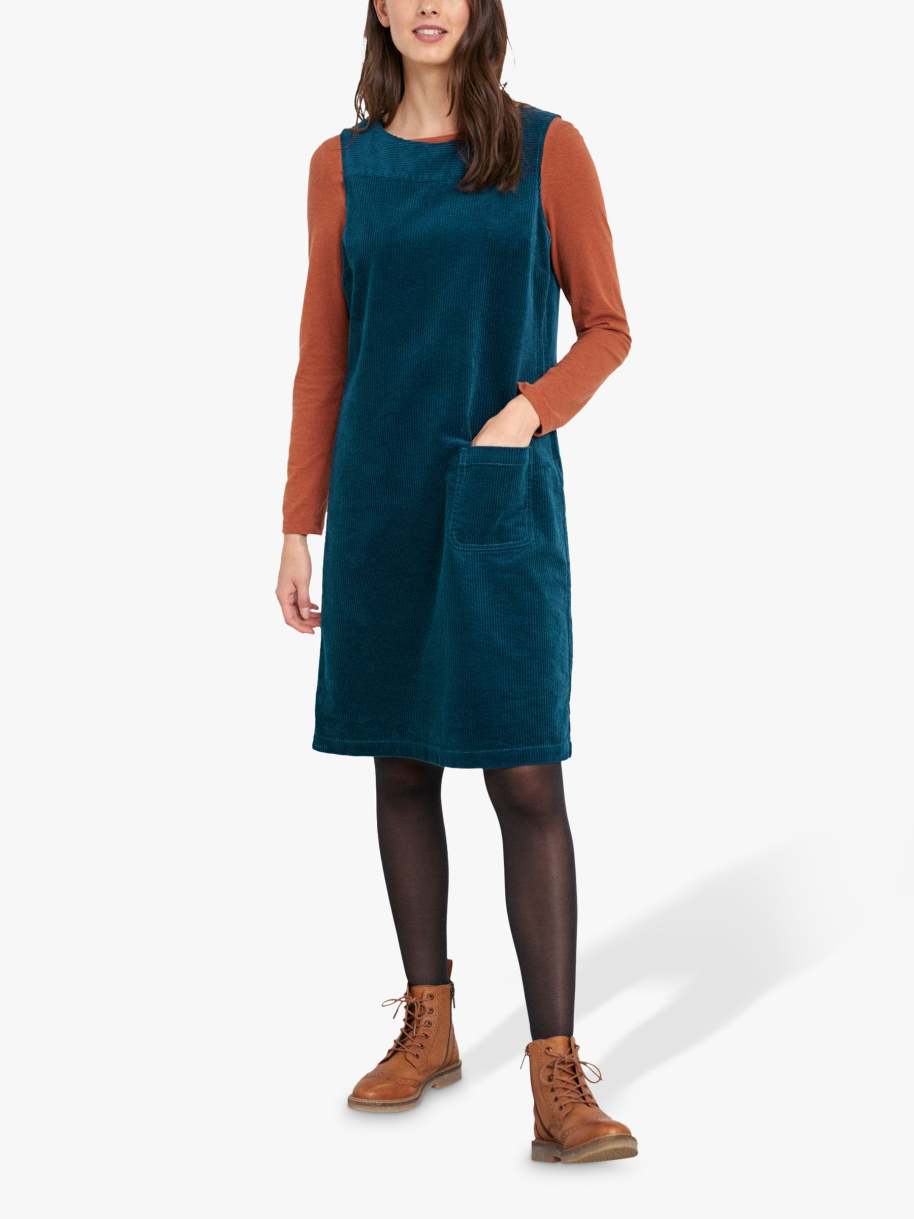 A studiowear-inspired women's pinafore dress in chunky cord fabric, this knee-length style is perfect for layering. Finished with a scoop neck and patch pocket, wear yours over a striped jersey and team with boots.