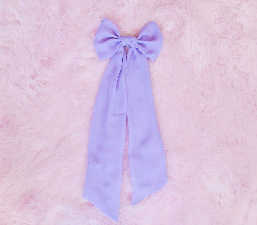 I love vintage dresses with giant chiffon bows on the front, so I decided to whip up a large bow with some clips on the back so I can wear it with any of my dre