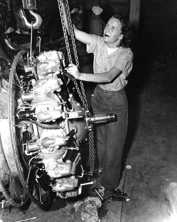 world war ii women aviation machinists mate elizabeth abercrombie uses a chain fall to