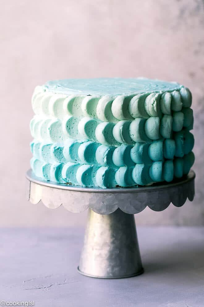 A Metal Cake Stand With 6 Inch Funfetti Cake Decorated With