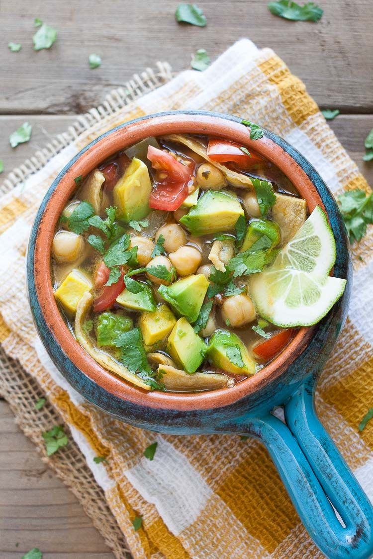 vegan Chickpea Soup topped with avocado and lime wedges