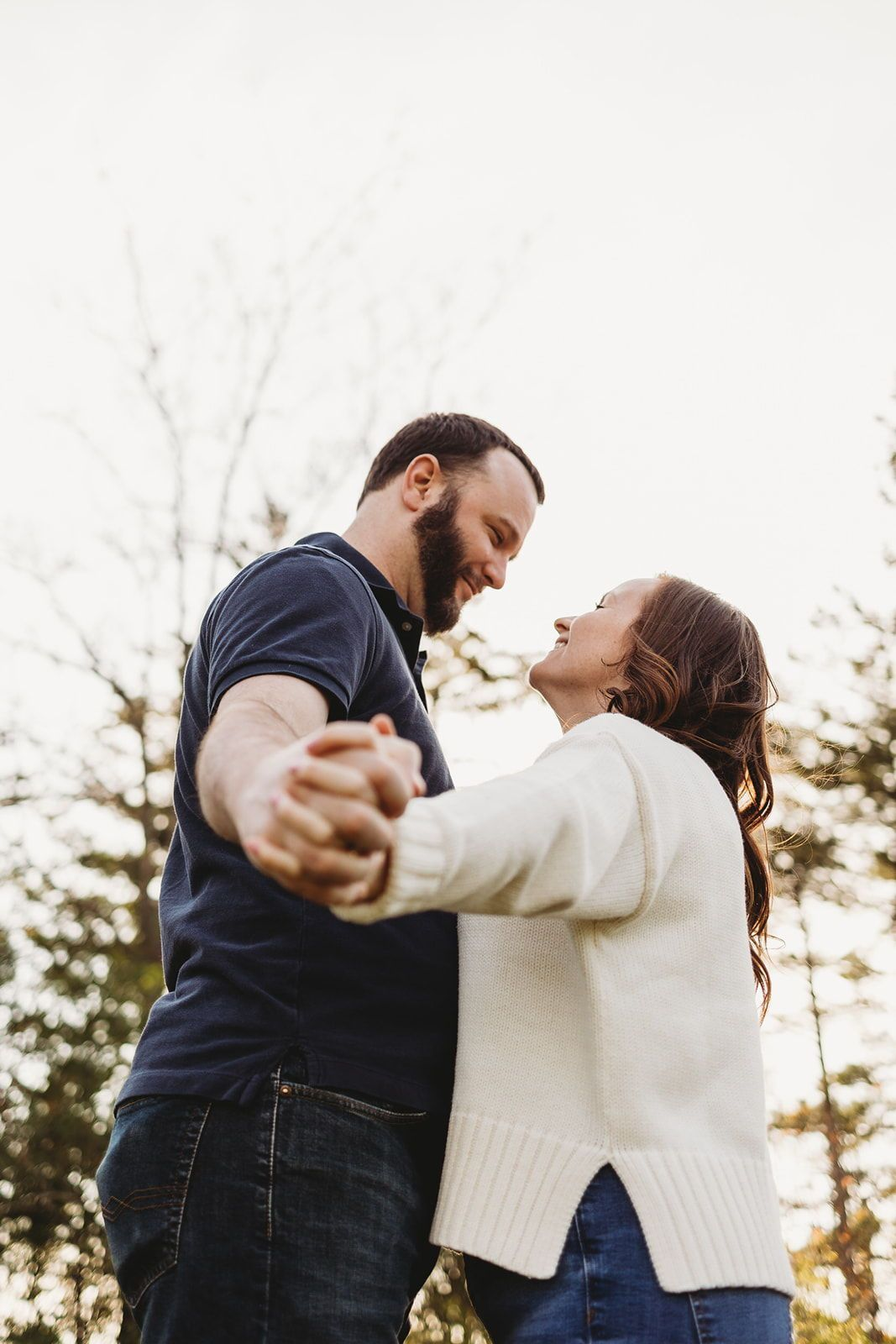 Cute engagement session at western Michigan university in park. Perfect inspiration for couples photo shoot poses ideas. Couple holding hands showing off her engagement ring. Engagement photo shoot inspiration in fall! Traveling Wedding and Couples Photographer. Lindsay Elaine Photography.