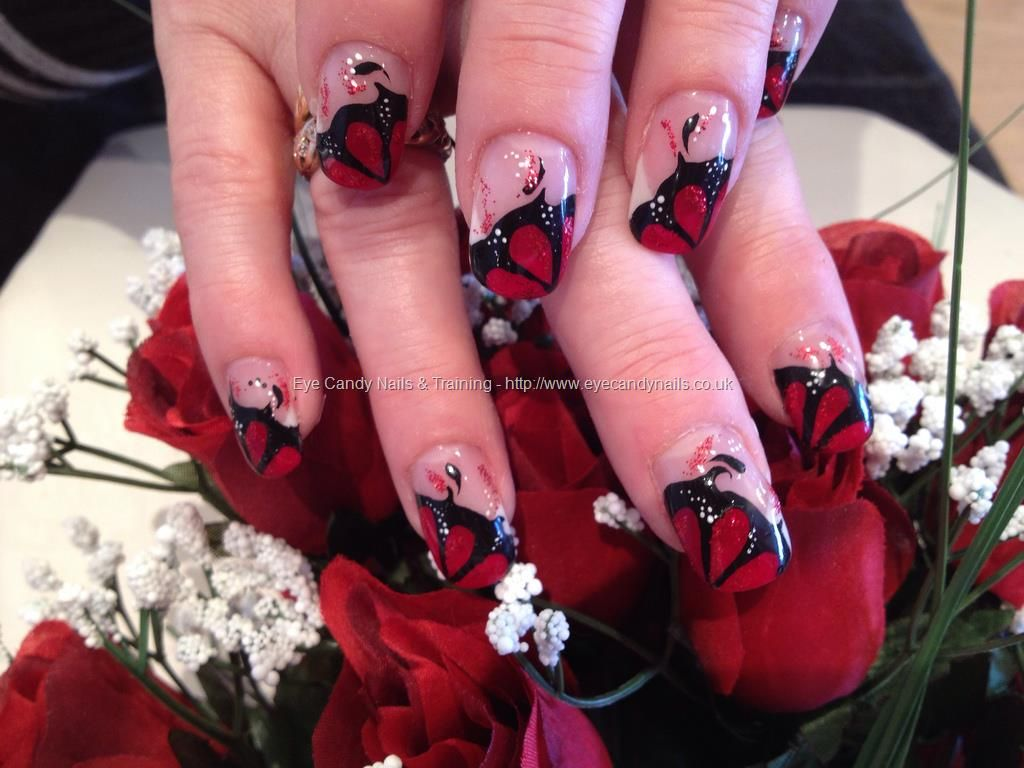 red and black freehand nail art over acrylic nails | nails