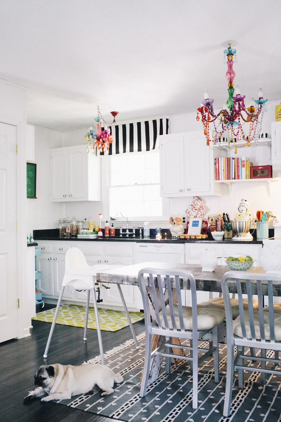 Black & white and color all over! An incredible kitchen   Read more - http://www.stylemepretty.com/living/2013/09/23/flora-faunas-home-tour/