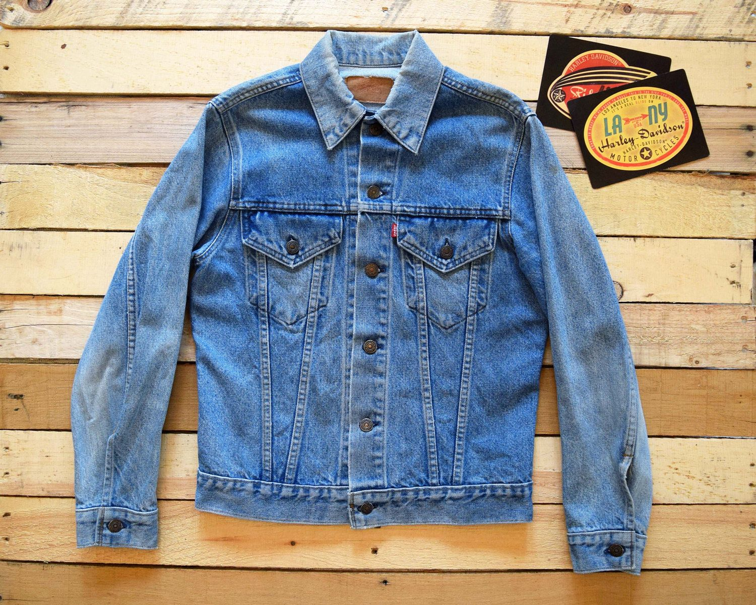 The Classic Type Iii Levis Trucker Jacket From The 70s Mid 80s In A Light Blue Stonewashed Denim This Jacket Has A Small E Red Denim Stone Wash Trucker Jacket
