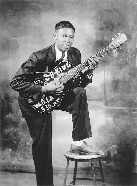 "VERY Young B.B. King - American History of Jazz & Blues music. B&W vintage photo with a personalized guitar! RESEARCH #DdO:) https://www.pinterest.com/claxtonw/jazz-and-all-that/ - WHY ""LUCILLE?"" In winter 1949, King played at a dance hall in Twist, Arkansas. 2 men started fighting over woman by that name, knocked over heating barrel. 2 men died in fire. King had run back in to get beloved $30 Gibson guitar. He named it & each guitar since LUCILLE to remember: NEVER be that stupid."