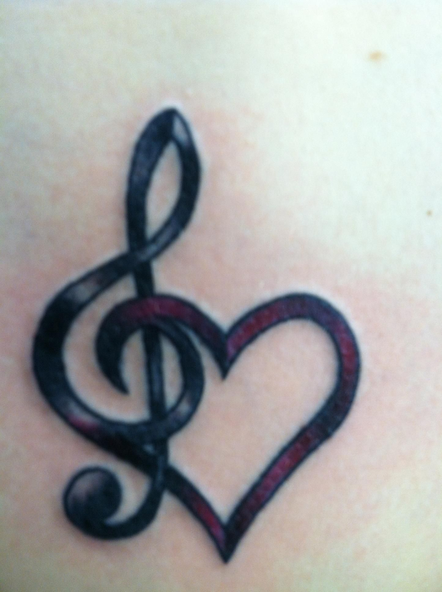10 most beautiful tattoo designs for lovely women music tattoos for the love of music pretty music note heart shape tattoo biocorpaavc Gallery