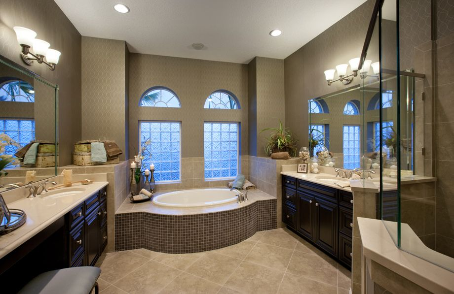 Time to relax in a nice luxurious bath toll brothers at for Model home bathroom photos