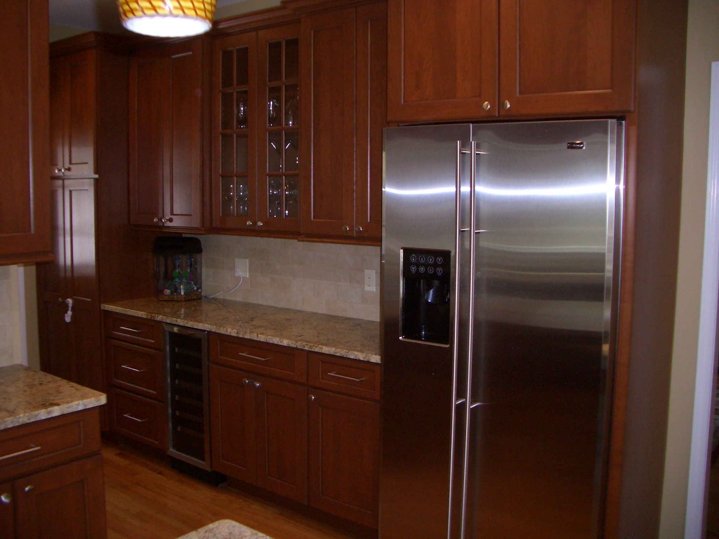 Majestic Kitchens And Bath Designer Roberto Leira. Cabinetry: Cabico In A  Cherry Wood With A Chestnut Brown Glaze   Golden Beach Granite Counter Tops.