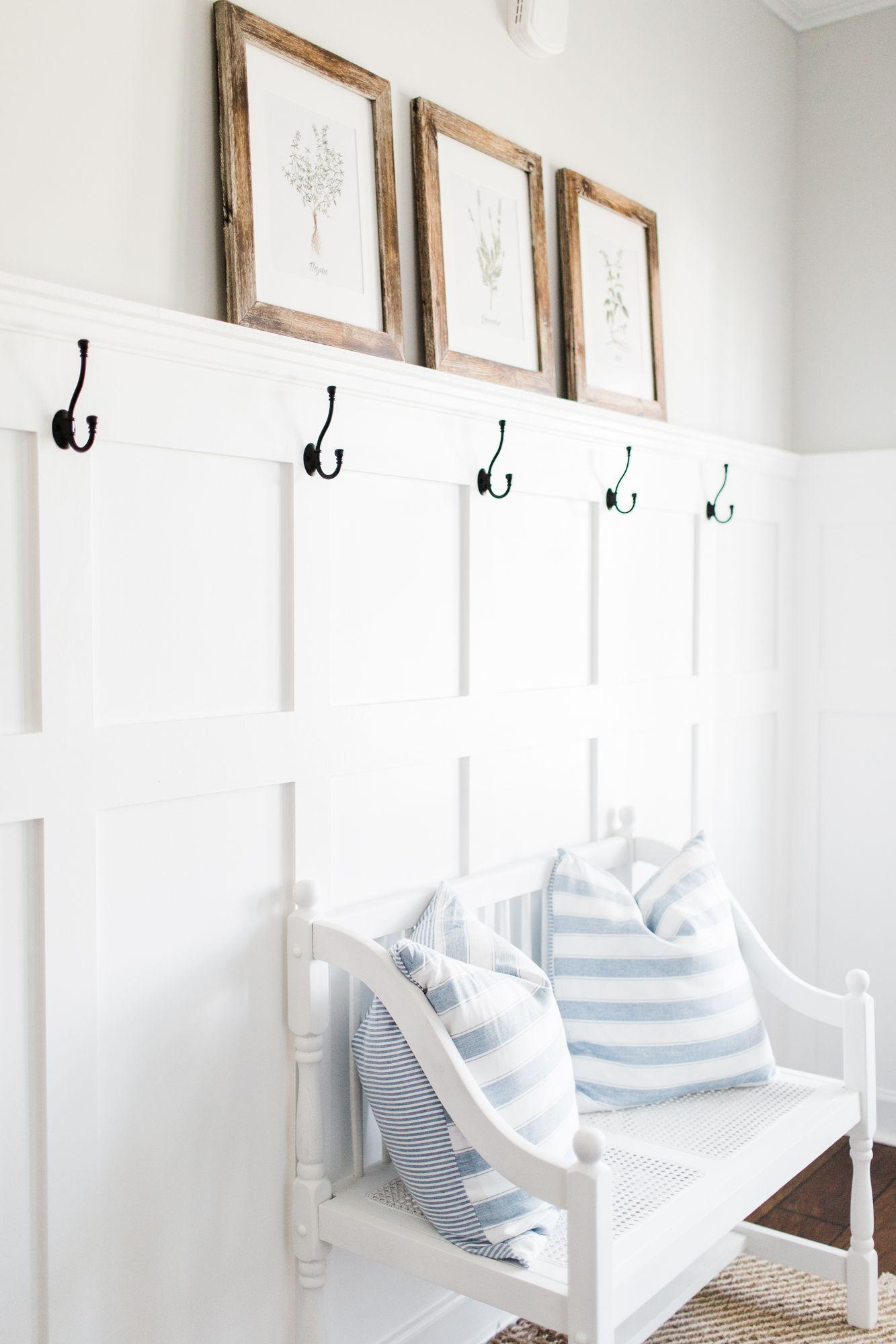 Modern Farmhouse Entryway Reveal | I honestly couldn't wait to finish the entire board and batten tutorial before sharing some of these pictures. Don't worry, the step-by-step tutorial is headed your way! Our entry way feels so cozy and inviting , and the decor can be easily changed with the seasons. #boardandbattenwall