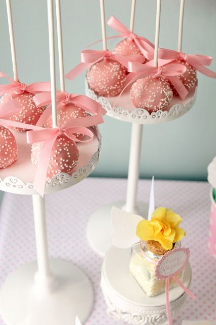 I like the ribbons tied at the bottom of the cake pop stick
