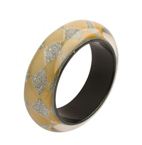 http://www.econe.co.uk/harlequin-gold-silver-glitter-bangle.html  Harlequin Gold & Silver Glitter Bangle by Nicholas King - Hand cast resin cuff embedded with a harlequin pattern of gold and glittery silver. Flamboyant and fun, it looks great worn on the wrist alone, or paired with another cuff.