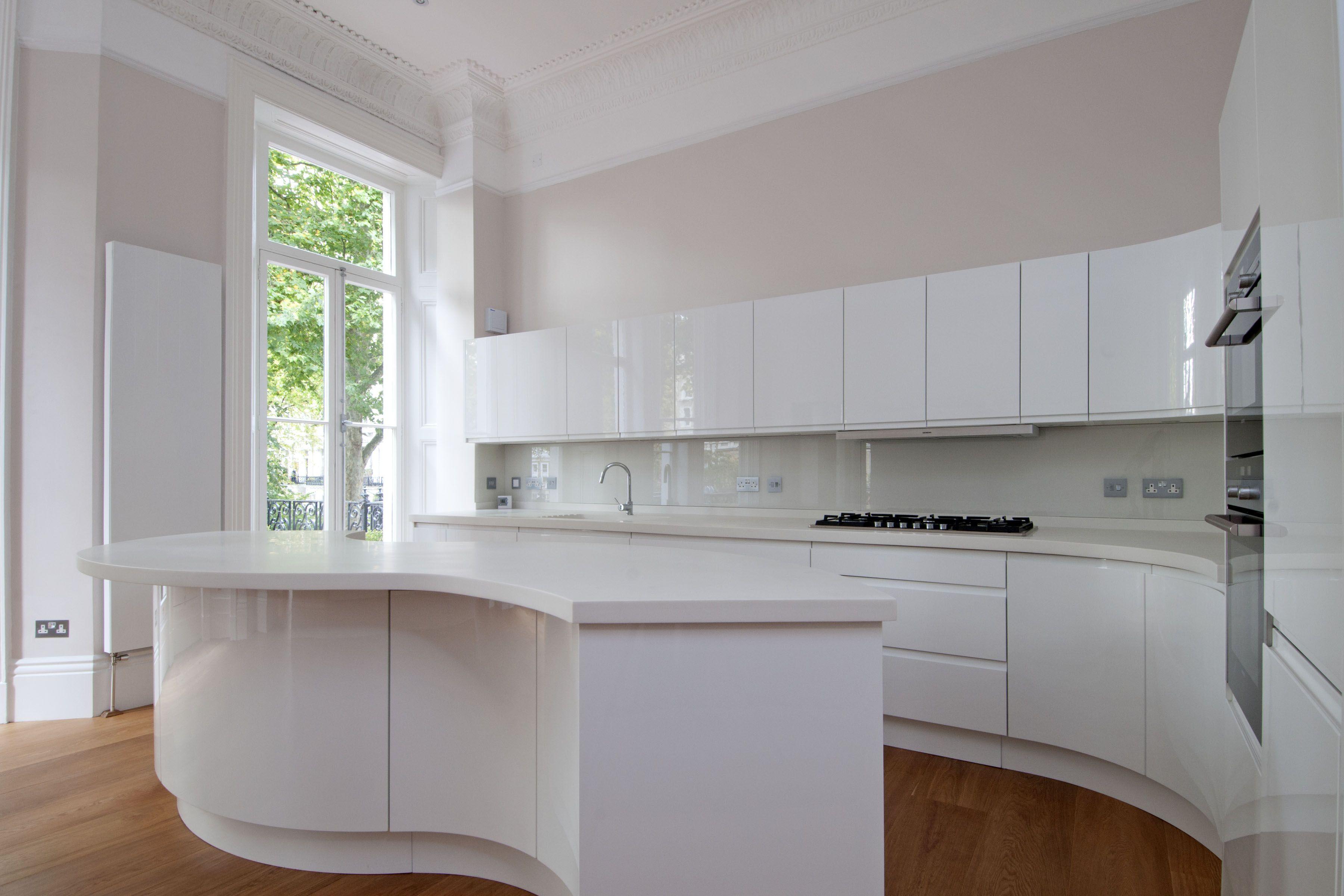 High Gloss Handleless Kitchen With S Shaped Island Corian Worktop Nice Ideas