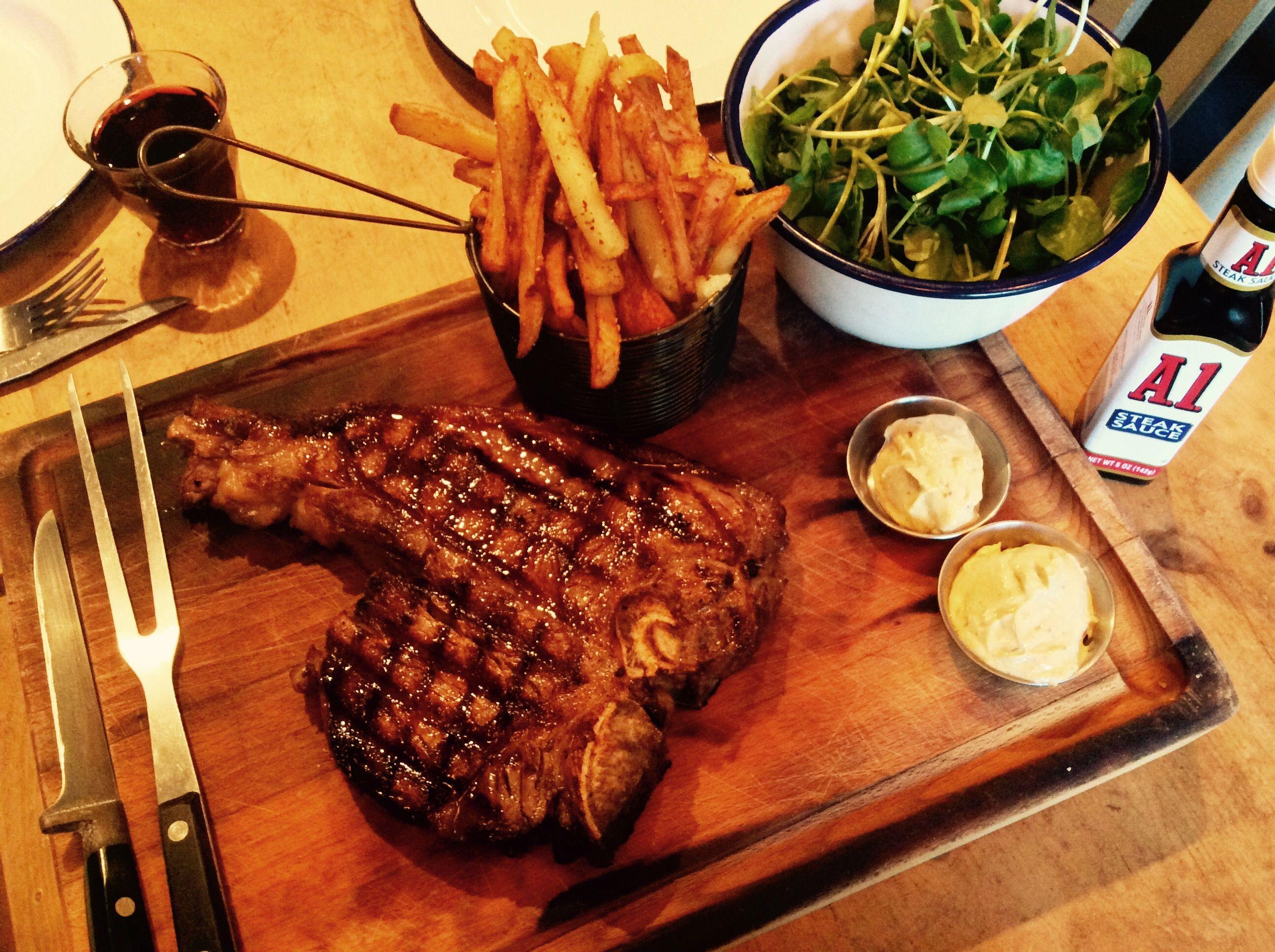Sharing T-Bone of dry aged steak. Served with watercress salad, seasoned fries, horseradish and mustard.