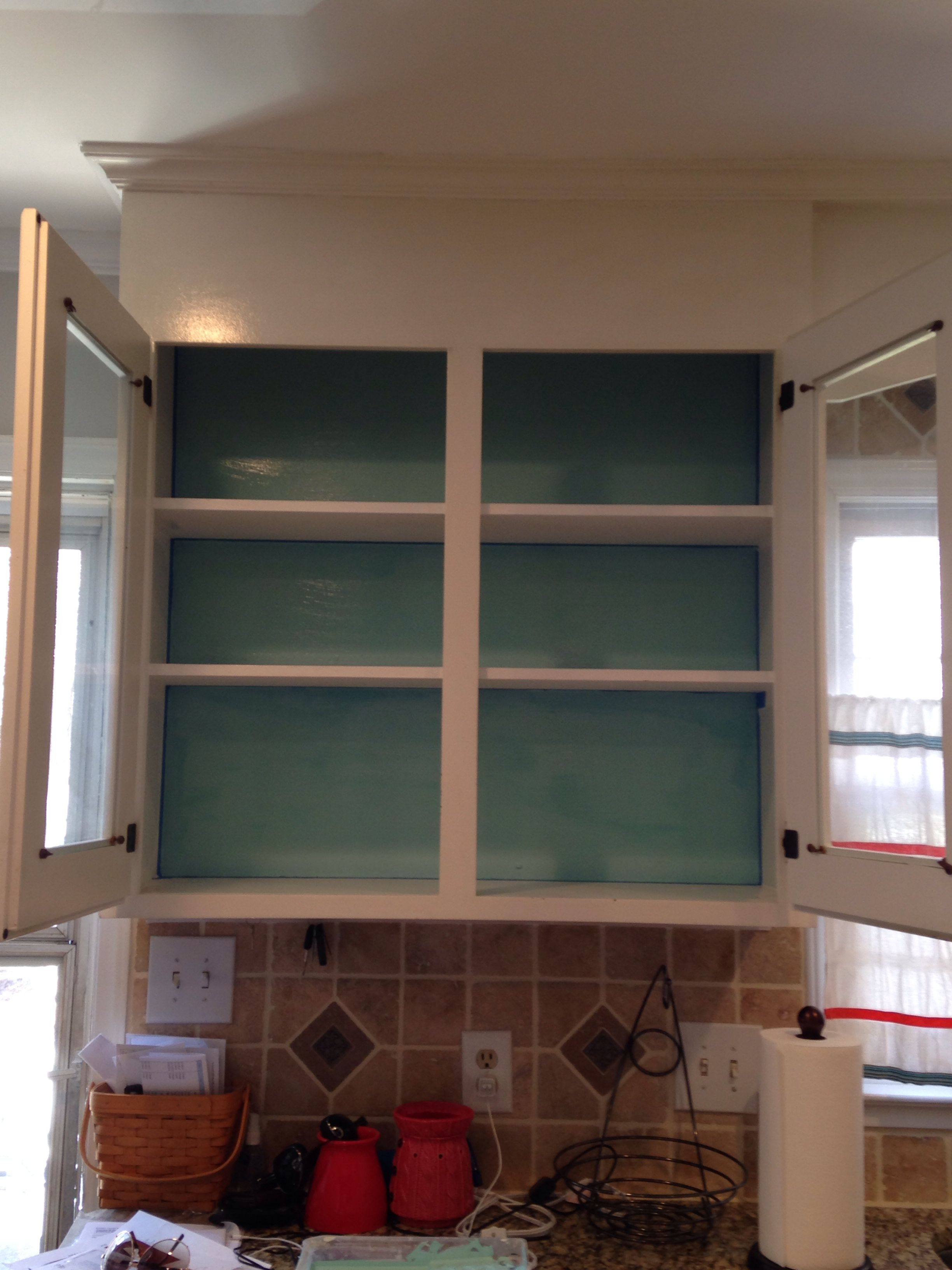 Turquoise paint on back of cabinet