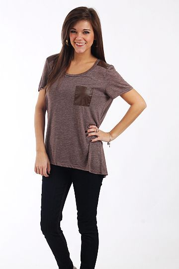 """Hi Lo Pocket Tee, Mocha $34.50  What a fun twist on a t-shirt! This super soft mocha top is cut like a t-shirt but has the added bonuses of a hi lo hemline, front pocket and leatherette panels on the top of the shoulders. Très chic!!!   Fits true to size. Miranda is wearing a small.   From shoulder to hem:  Small - 26""""  Medium - 26.5""""  Large - 27"""""""
