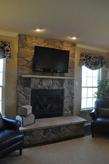 Building A Ryan Homes Ravenna Tv Over The Fireplace Or Not Basement Remodeling Home Fireplace Rustic Remodel