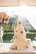 The perfectly smooth and polished ivory coloured fondant icing on this large Wedding Cake created a wonderful backdrop for the softly cascading fresh flowers. Here you see it sitting perfectly in it's chateau garden setting in Grasse.  Pamela designs and makes Wedding Cakes for destination weddings in the French Riviera, Provence, Var and Alpes Maritime. Delivering throughout the region from Monaco, Nice, Cannes, to Saint Tropez & Aix en Provence and everywhere in between.