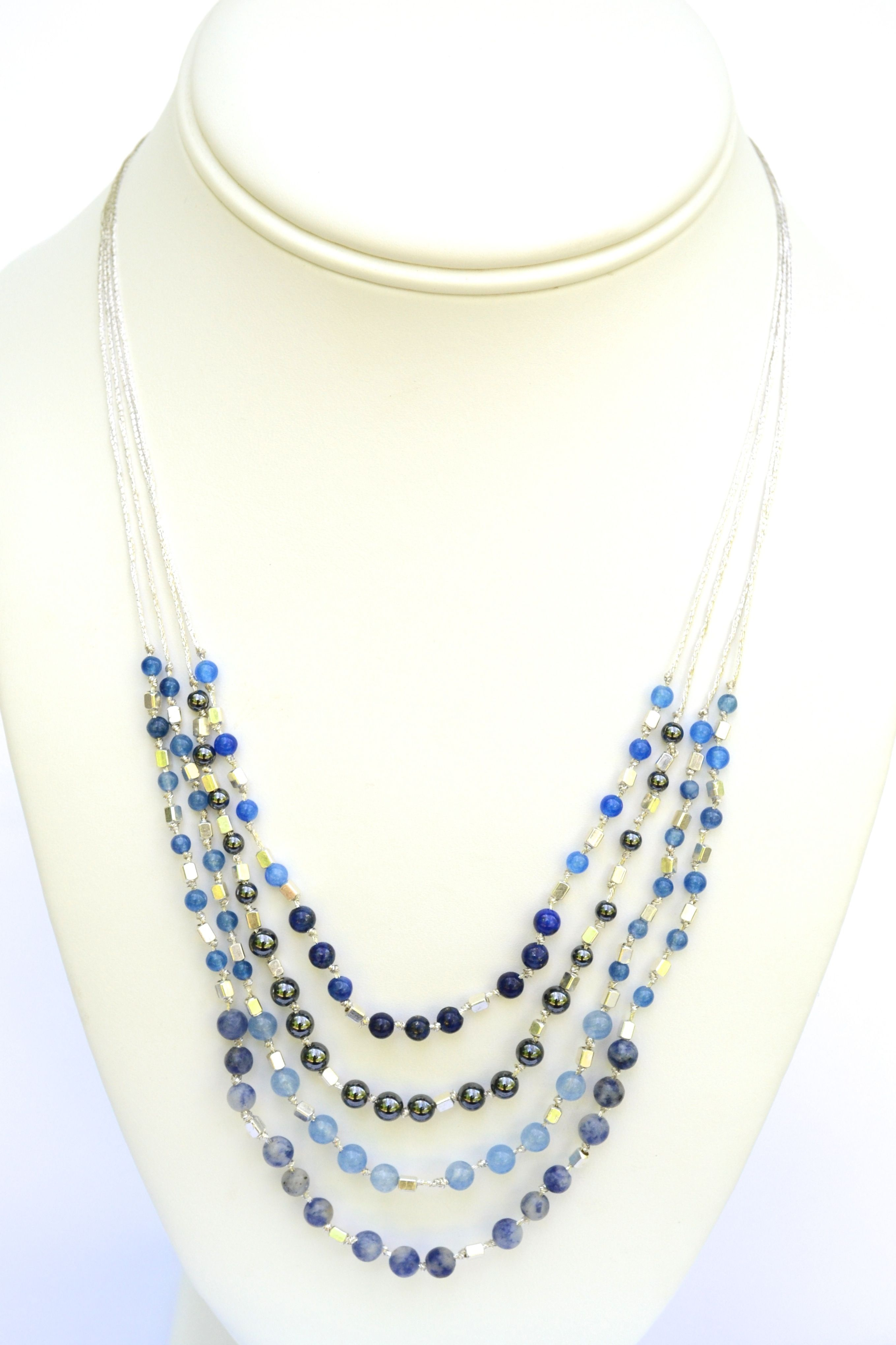 Brooke - This is a playful, easy to wear necklace using semi precious stones on silk thread.