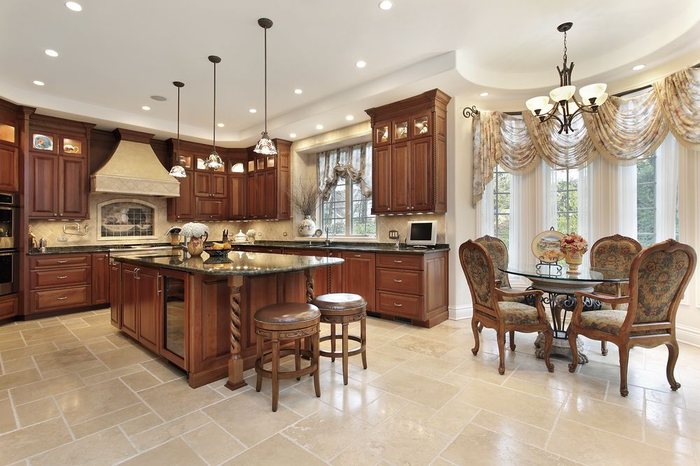 U shaped kitchen in upscale home with wood cabinets tile for House plans with gourmet kitchens