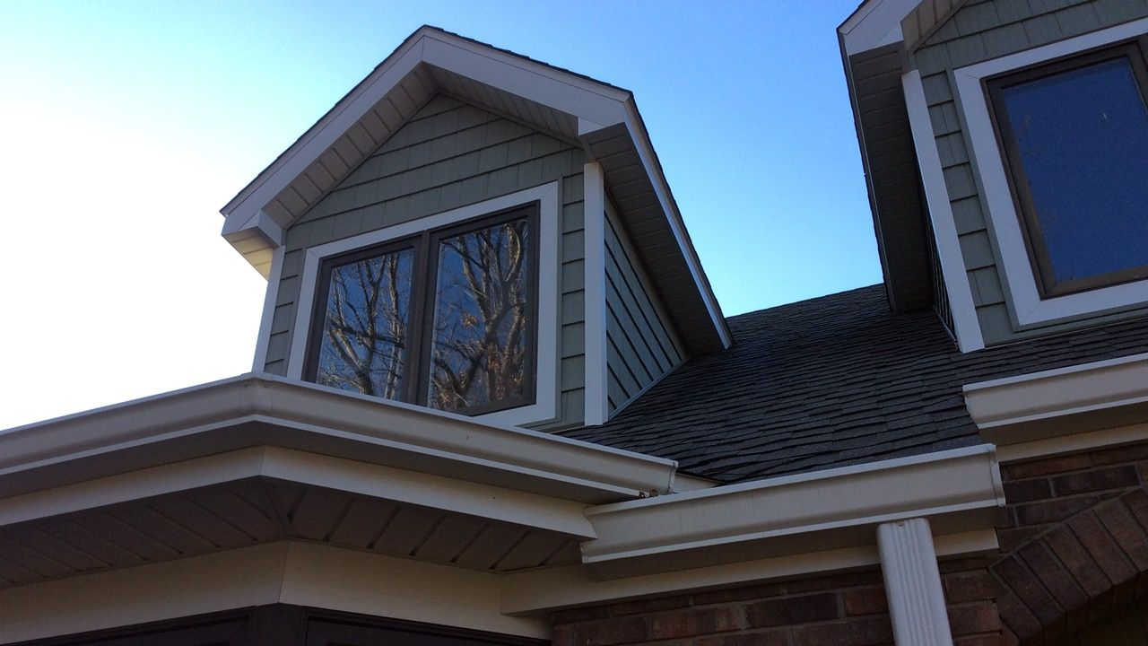 Vinyl shake siding installed on dormers in the color for Cypress color vinyl siding