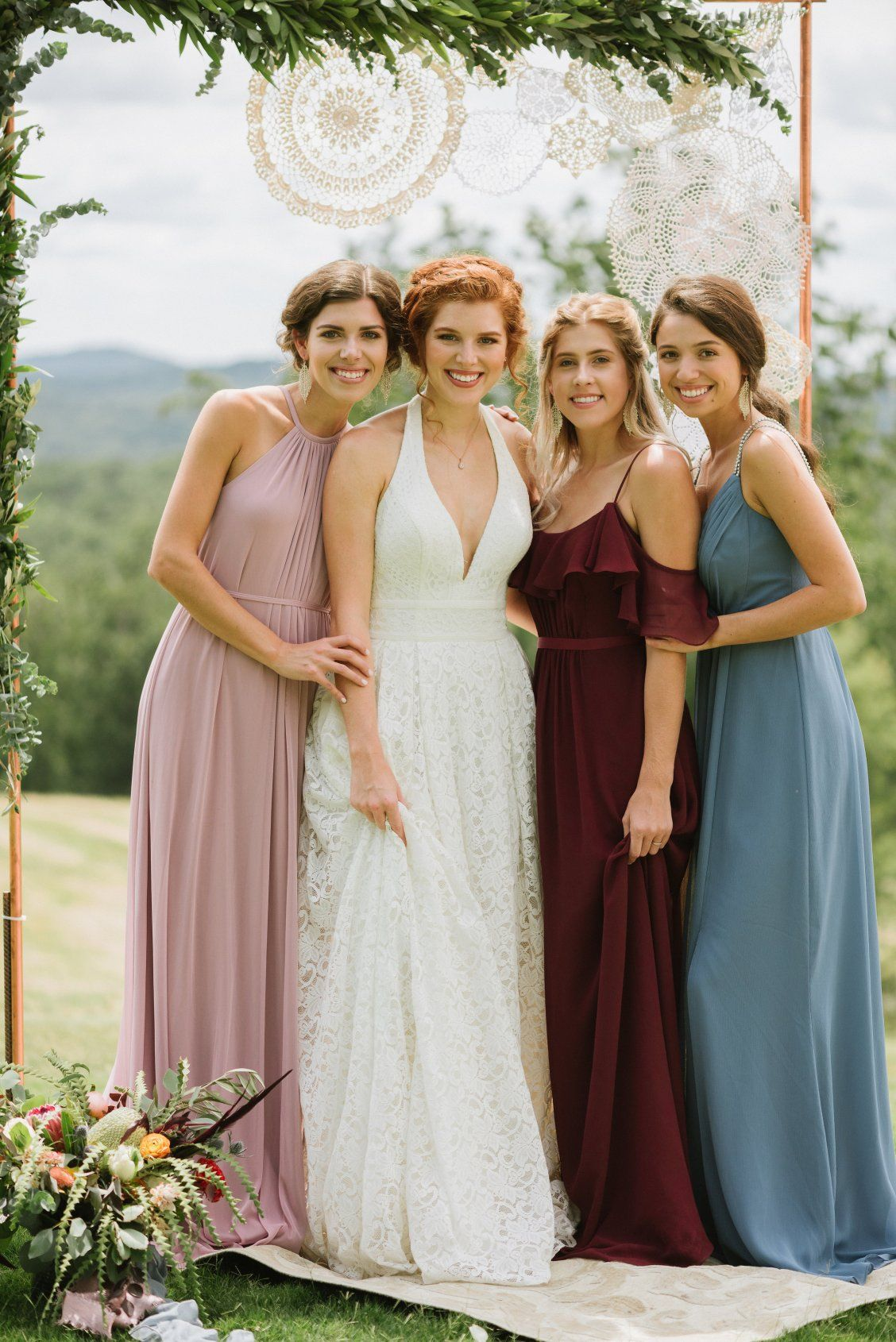 e361f71ec68 A bohemian wedding calls for flowy bridesmaid dresses and dusty wedding  colors! Shop this entire bridal party from David s Bridal!