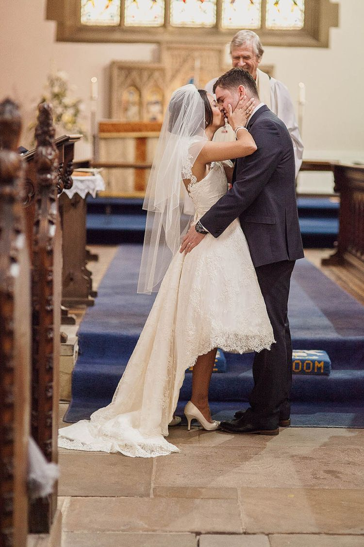 A us style gown and a us inspired short and pretty pouffy veil