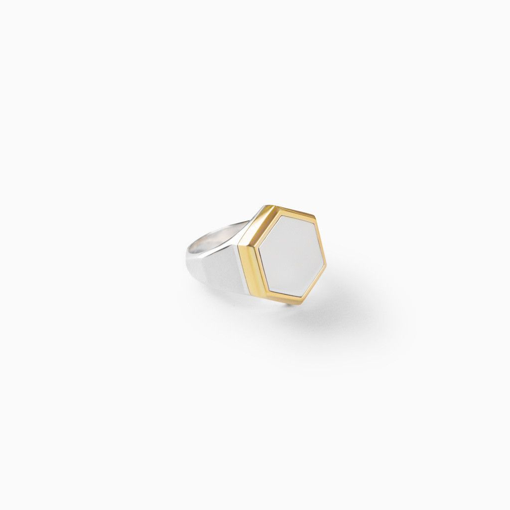 Handcrafted from solid sterling silver, the already favorite Hex Ring features a smooth, polished hexagon face and a 22k gold plated faceted border. This classic take on the signet ring is sleek and s