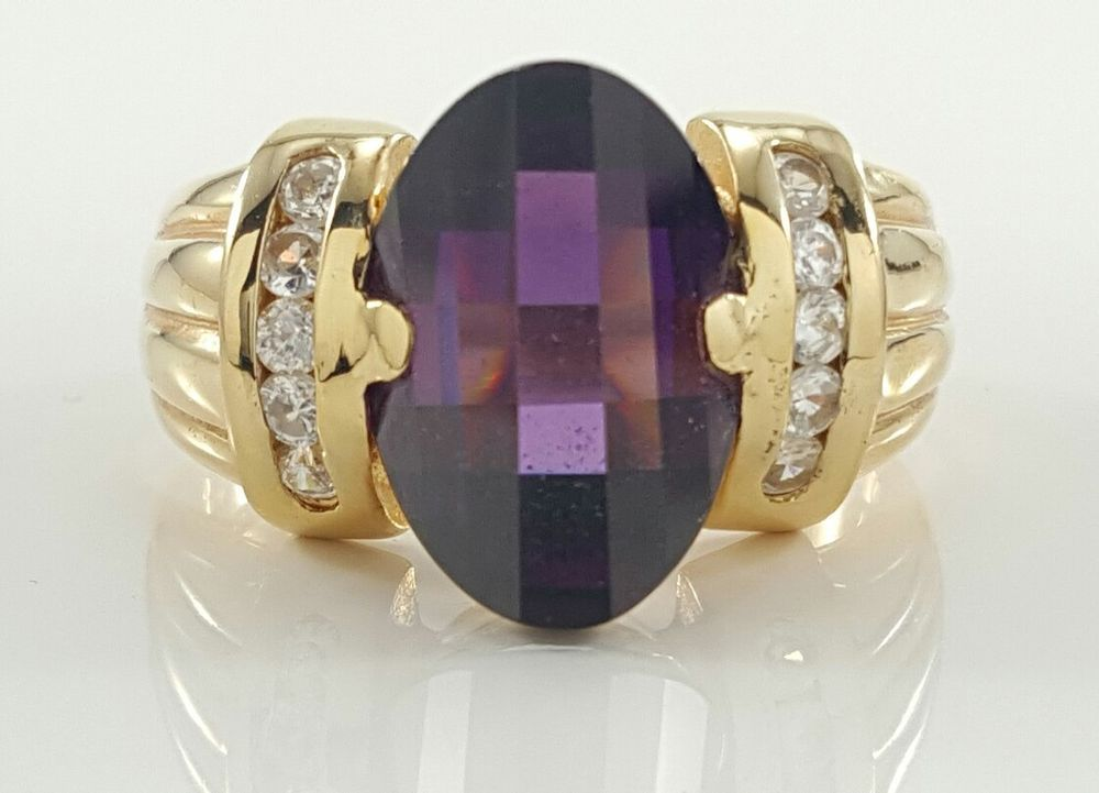 """There are some minor scratches on the ring.<br/><br/>Featured here is an elegant Laura Ramsey fancy Amethyst setting with CZ accent setting in vermeil sterling silver ring. Cut: Fancy. Metal: Gold over Sterling Silver. Top Dimension: 9/16"""". Shank Dimension: 1/8"""". 