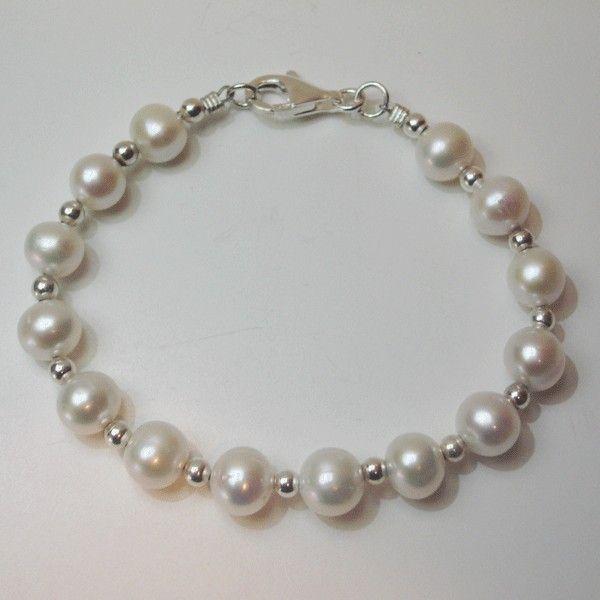 4f40c5256e0b Preciosa pulsera con perla cultivada y bolas de plata montada en hilo de  acero al mejor precio !one